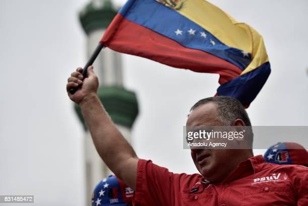 Member of the National Assembly of Venezuela Diosdado Cabello waves a flag of Venezuela during a rally to support Venezuelan President Nicolas Maduro...