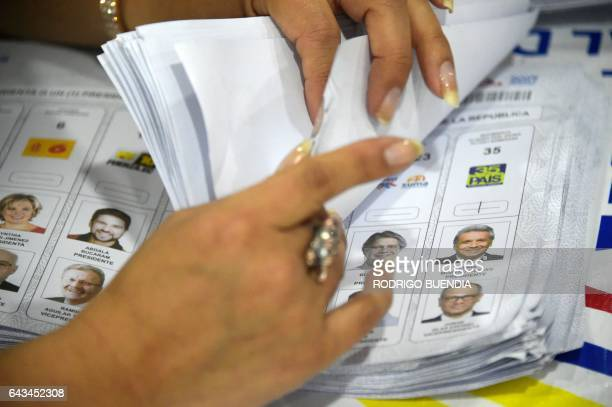 A member of the National Electoral Council counts votes in Quito on February 21 2017 The delay in the release of the results of Sunday's elections...