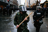 A member of the National Guard joins the Seattle Police in quelling protests during the World Trade Organization's 1999 conference in Seattle What...