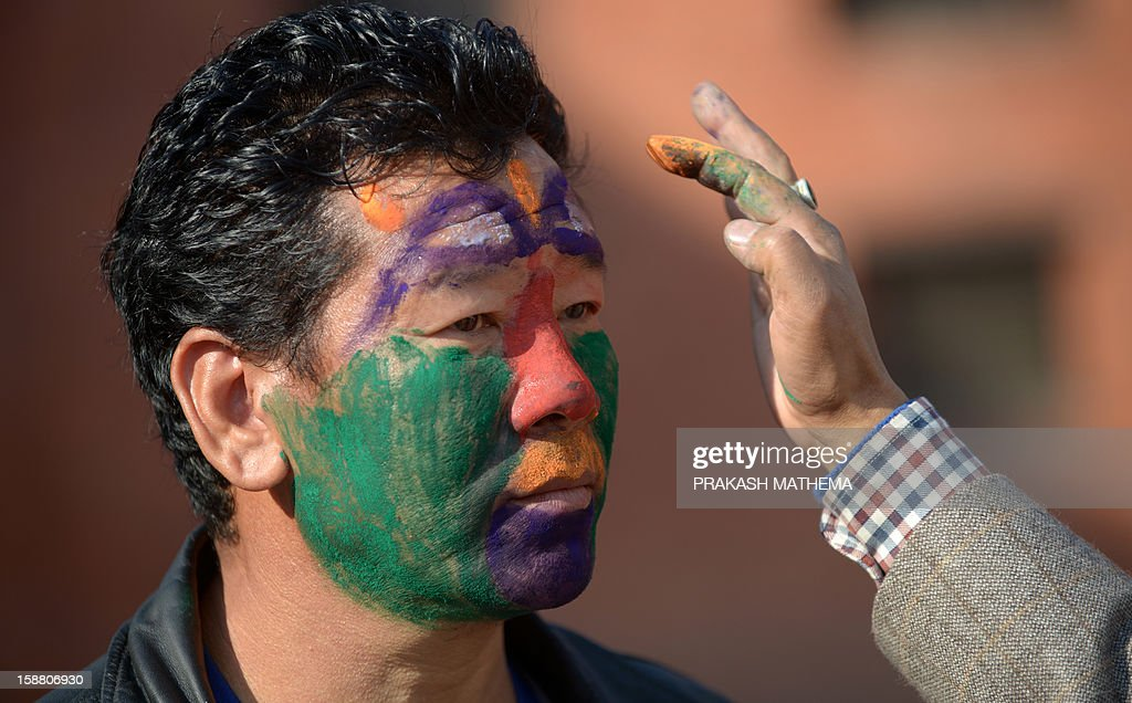 A member of the Nepalese indigenous Gurung community is made up as he prepares to take part in a New Years celebration ceremony known as 'Tamu Lhosar ' in Kathmandu on December 30, 2012, held to celebrate their New Year or Lhosar. Gurungs number some 700,000 people about three percent of the Himalayan nation's population and are mainly concentrated in the country's central region. AFP PHOTO/Prakash MATHEMA