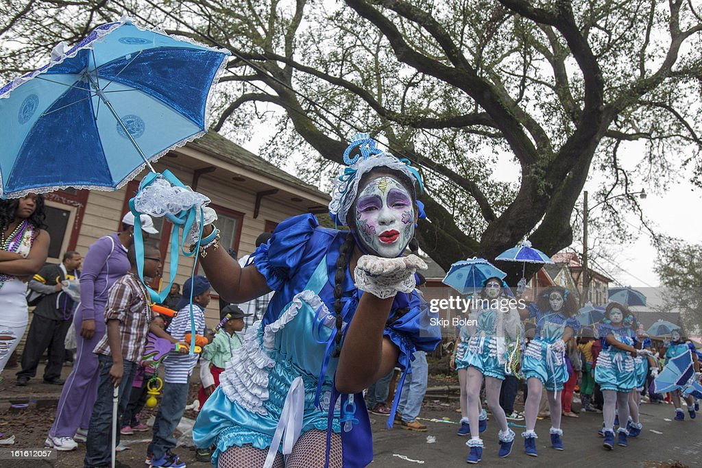 A member of the New Orleans Baby Doll Ladies poses in the Zulu Social Aid & Pleasure Club's 'Zulu Parade' on Jackson Avenue, the first parade on the morning of 2013 Mardi Gras on February 12, 2013 in New Orleans, Louisiana.