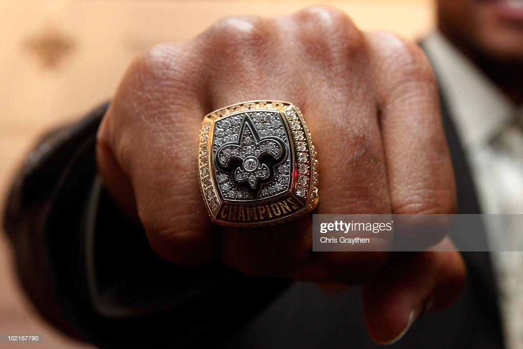A member of the New Orleans Saints shows off his ring from Super Bowl XLIV on June 16, 2010 in New Orleans, Louisiana.