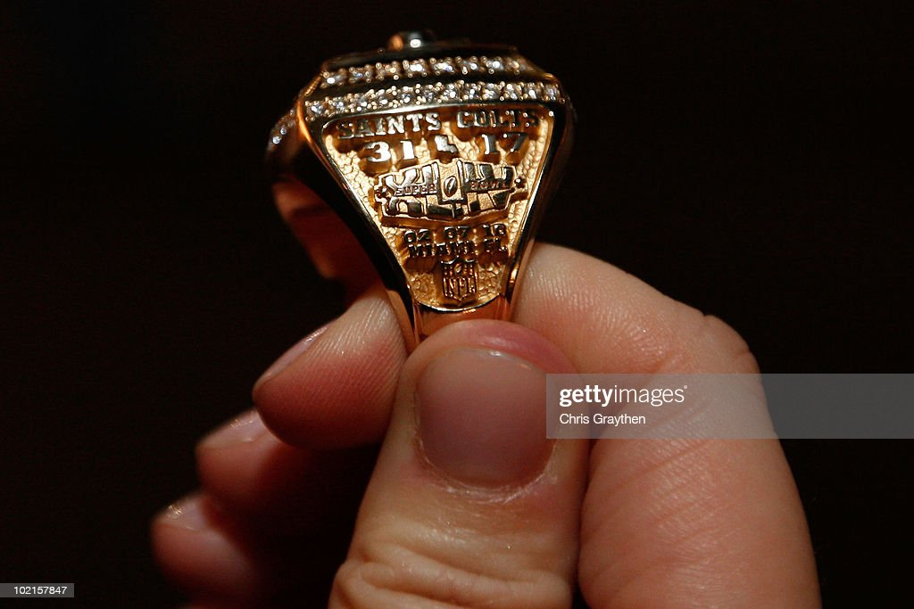 A member of the New Orleans Saints shows off their ring from Super Bowl XLIV on June 16, 2010 in New Orleans, Louisiana.