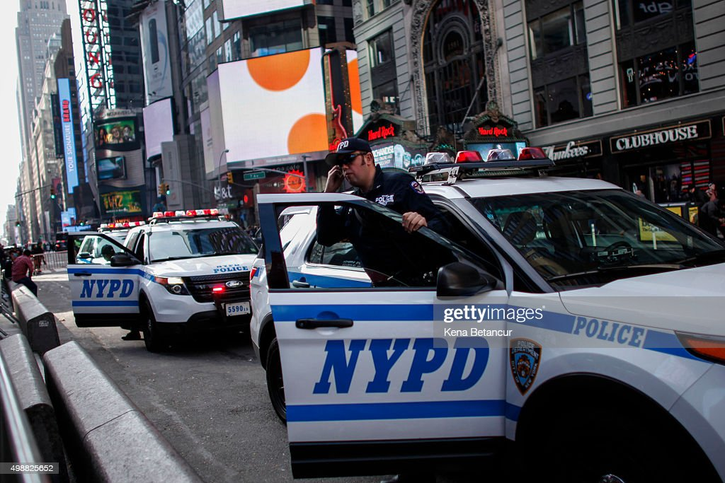 A member of the New York City Police department exits from a car in Times Square on November 26 2015 in New York City A record number of police...