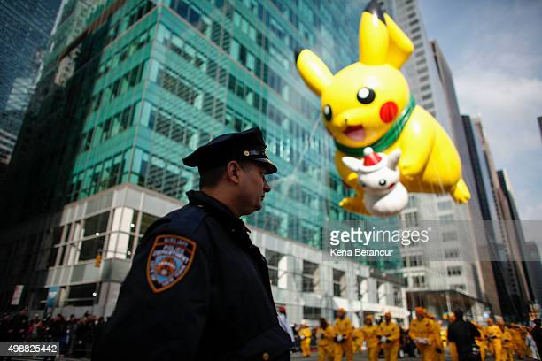 A member of the New York City Police department stands guard during the annual Thanksgiving Day Parade on November 26 2015 in New York City A record...