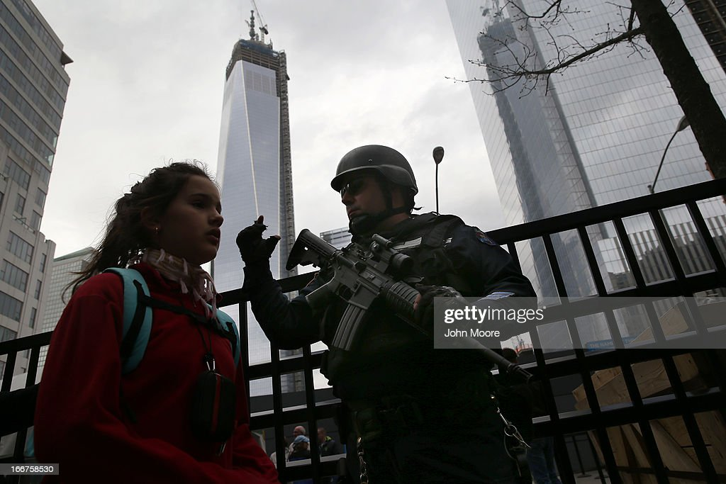 A member of the New York City Police Department's 'Hercules Team' moves pedestrians along near the One World Trade tower on April 16, 2013 in New York City. The high-visibility special forces type police unit was deployed outside the September 11 Memorial and Museum as security was raised throughout New York City a day after the Boston Marathon attacks.