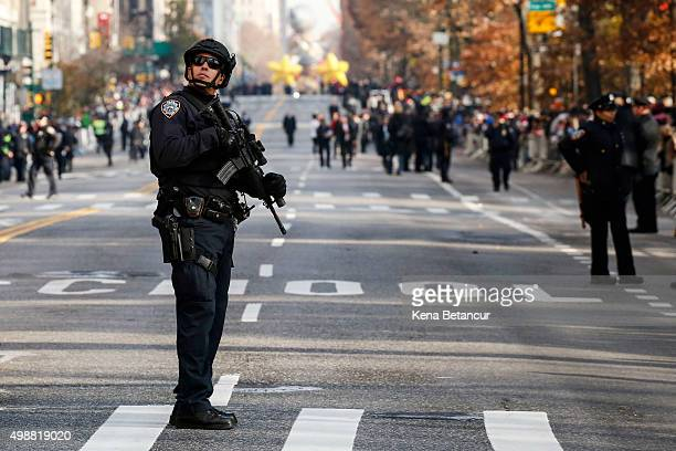 A member of the New York City Police special task force stands guard before the annual Thanksgiving Day Parade on November 26 2015 in New York City...