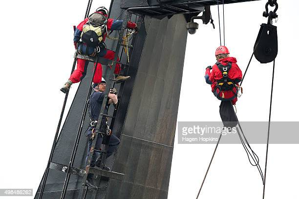 A member of the New Zealand Police talks to Greenpeace activists on the NIWA research vessel Tangaroa on November 24 2015 in Wellington New Zealand...