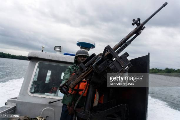 A member of the NNS Delta Of the Nigerian Navy forces during is out on patrol in the creeks looking for illegal oil refineries on April 19 2017 in...