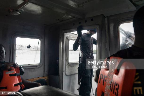A member of the NNS Delta Of the Nigerian Navy forces is out a patrol in the creeks looking for illegal oil refineries on April 19 2017 in the Niger...