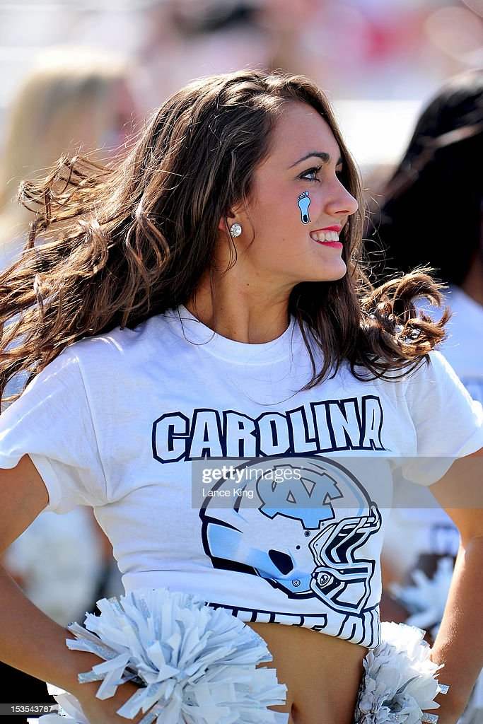 A member of the North Carolina Tar Heels dance team performs against the Virginia Tech Hokieson October 6, 2012 at Kenan Stadium in Chapel Hill, North Carolina.