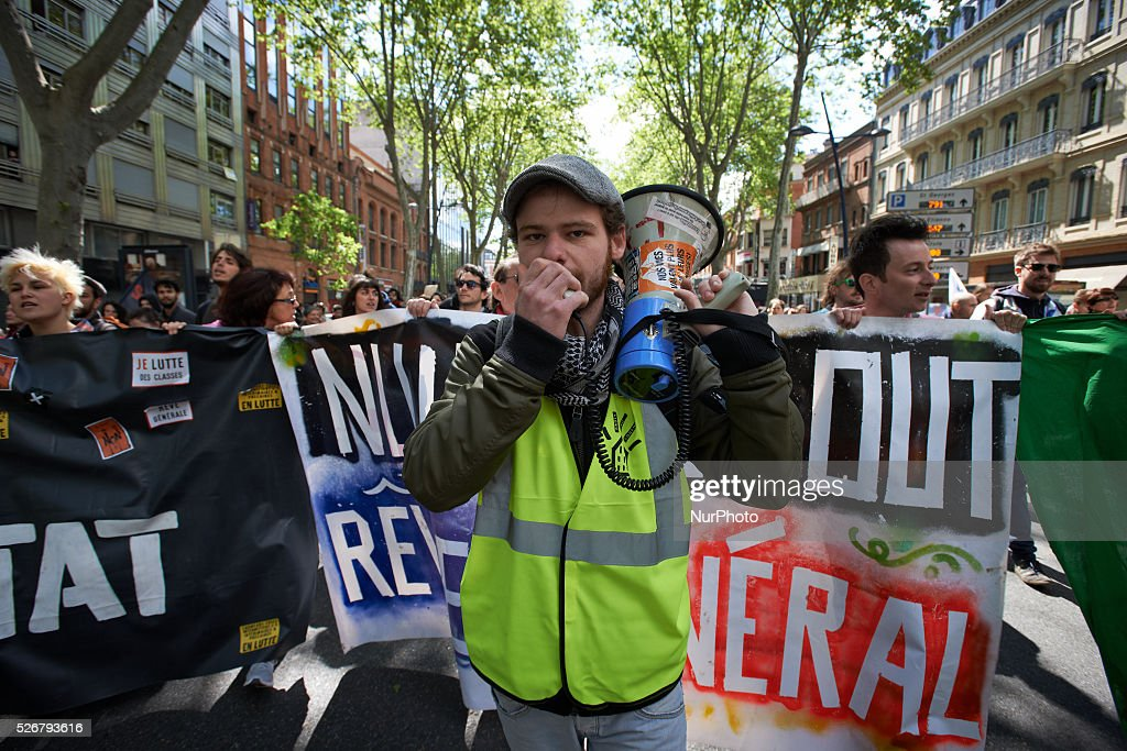 A member of the 'Nuit Debout' (Up All Night) movement shouts slogans against the EL-Khomri bill on labour reforms during the traditionnal march for Labor Day on May 1st. Toulouse. France. May 1st 2016.