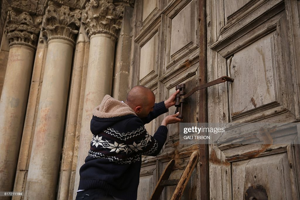A member of the Nuseibeh family the Muslim doorkeepers of the Church of the Holy Sepulchre closes the door after the Holy Thursday mass in...