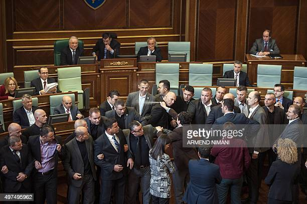 Member of the opposition party Vetevendosje Albin Kurti fires pepper spray to ministers in the Kosovo's parliament in Pristina on November 17 2015...