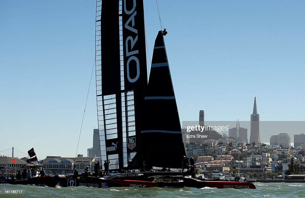 A member of the Oracle Team USA changes a sail after race 12 against Emirates Team New Zealand in the America's Cup Finals on September 19, 2013 in San Francisco, California. Oracle Team USA won race 12 and race 13 was postponed due to high winds.