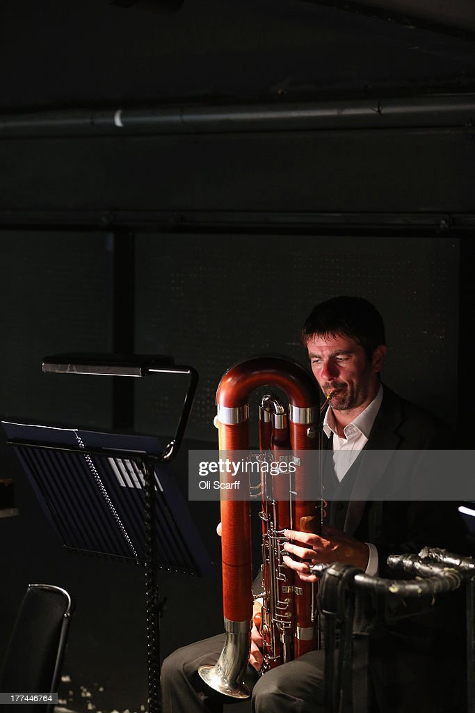 A member of the orchestra at Glyndebourne opera house tunes his instruments before a production of the Benjamin Britten opera 'Billy Budd' on August 22, 21013 in Lewes, England. The Glyndebourne Festival of six operas performed at the East Sussex opera house from May until August sees its final performance of the season on August 25, 2013. The Glyndebourne opera house stands in the grounds of the country home of John Christie, who founded it in 1934, today it is recognised globally as one of the world's great opera houses.