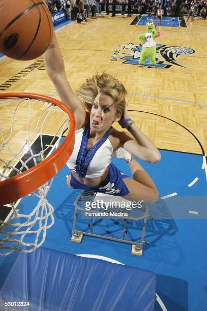 A member of the Orlando Magic Dancers dunks during a timeout against the Miami Heat in a game at TD Waterhouse Centre on April 20 2005 in Orlando...