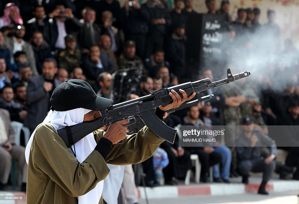 A member of the Palestinian Hamas female security forces shoots at a target during her graduation ceremony in Gaza City on March 19, 2013.