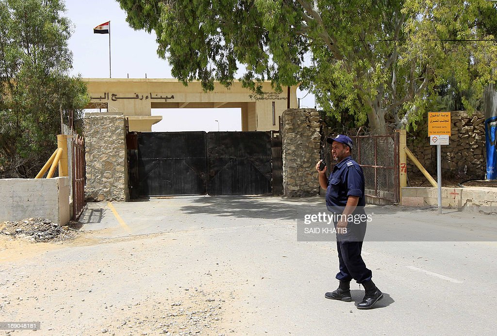 A member of the Palestinian Hamas security forces walks past the closed gate of the Rafah crossing with Egypt in the southern Gaza Strip on May 19, 2013. Egyptian policemen closed commercial crossing point on the border with Israel in solidarity with their comrades who closed the Rafah border crossing with the Gaza Strip for a third straight day to protest the kidnapping of seven policemen and soldiers in the region. AFP PHOTO / SAID KHATIB