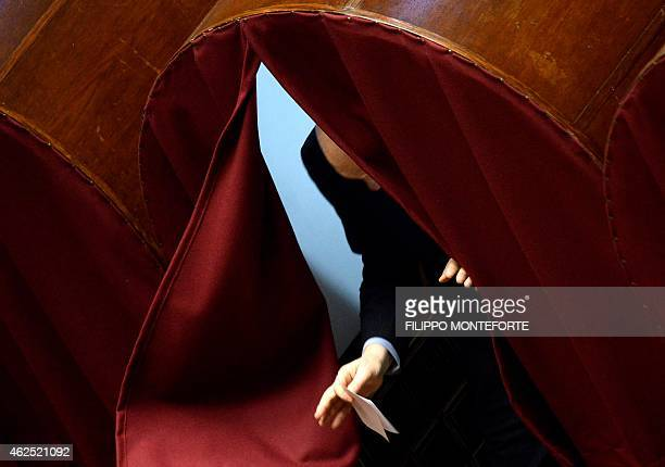 A member of the parliament leaves a polling booth as he prepares to vote at the Italian Parliament in Rome on January 30 on the second day of vote...