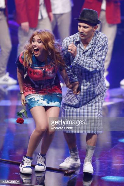 A member of the performer DMA Crew touches the bottom of Palina Rojinski during the 1st live show of 'Got to Dance' on August 1 2014 in Cologne...