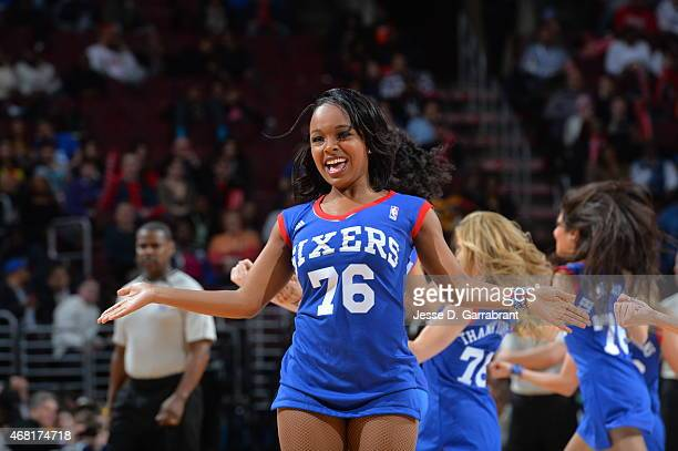 Member of the Philadelphia 76ers dance team performs for the crowd against the Los Angeles Lakers at Wells Fargo Center on March 30 2015 in...