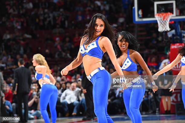 A member of the Philadelphia 76ers dance team performs for the crowd against the San Antonio Spurs at Wells Fargo Center on December 7 2015 in...