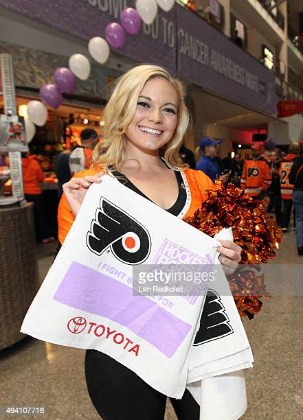 A member of the Philadelphia Flyers Ice Girls displays a 'I Fight For' rally towel prior to their game against the New York Rangers on October 24...