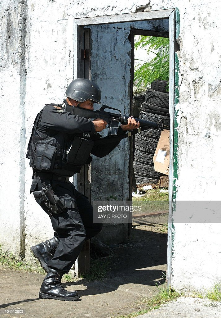 A member of the Philippine National Police Special Weapons ...
