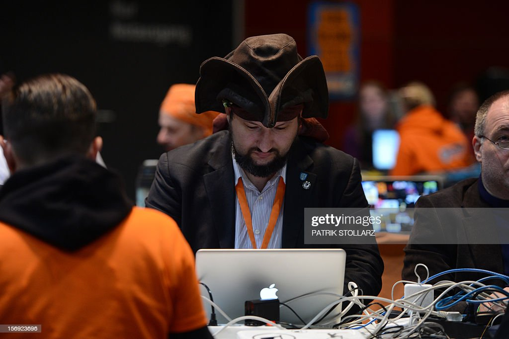 A member of the Pirate party follows a discussion at a party congress in Bochum, western Germany, on November 25, 2012. The Pirate Party is meeting for two days to prepare a party platform for the 2013 general elections. AFP PHOTO / PATRIK STOLLARZ