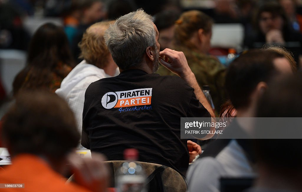 A member of the Pirate party follows a discussion at a party congress in Bochum, western Germany, on November 25, 2012. The Pirate Party is meeting for two days to prepare a party platform for the 2013 general elections.