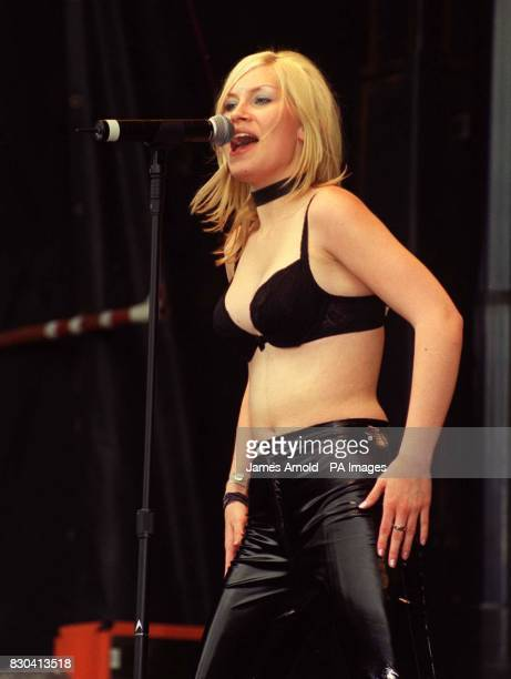 A member of the pop group Bucks Fizz performing on stage at the Mardi Gras 2000 festival in London's Finsbury Park