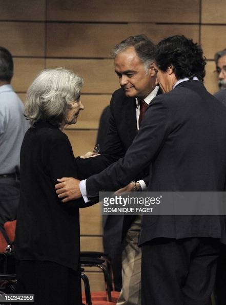 Member of the Popular Party Esteban Gonzalez Pons conforts Carmen Menendez wife of Spain's former Communist Party leader Santiago Carrillo at a...