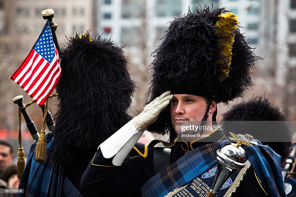 A member of the Port Authority Pipes and Drums band stands at attention during the 20th Anniversary Ceremony for the 1993 World Trade Center bombing at Ground Zero on February 26, 2013 in New York City. The attack, which utilized a car bomb and hit the north tower, killed six people.