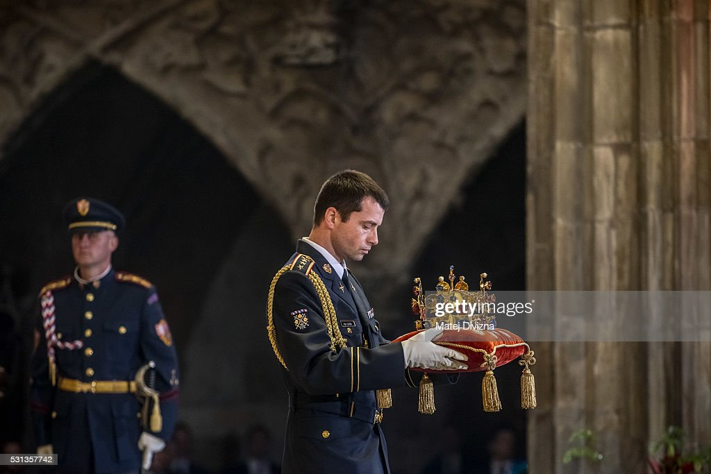 A member of the Prague Castle Honour Guard carries the St. Wenceslas Crown during a mass on the occasion of the 700th anniversary of the birth of Emperor and King Charles IV celebrating by Prague Archbishop Cardinal Dominik Duka at the St. Vitus Cathedral on May 14, 2016 in Prague, Czech Republic. The Anniversary is to be marked with commemorative events in Prague and around the Czech Republic. Celebrations start on May 14, on the day when Charles IV was born. Charles IV, of the Luxembourgh dynasty, was German King, King of Bohemia and Holy Roman Emperor from 1335 until his death in 1378. In modern day, Charles IV is still regarded as the 'father of the country' in the Czech Republic. During his reign Prague became the capital of the Holy Roman Empire.