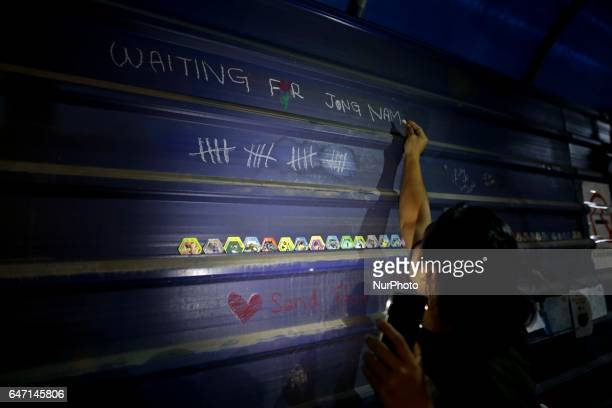 A member of the press write on the temperory wall infront of the mortuary of the Kuala Lumpur Hospital while waiting for any update on the Kim Jong...
