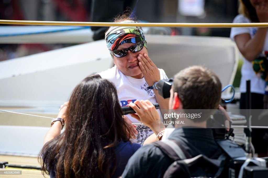 A member of the PSP Logistics crew cries as she is interviewed Saint Katherine's Dock in London, England after completing the 2013-14 Clipper Round the World Yacht Race, on July 12, 2014. The world's longest ocean race began on September 1, 2013, with a 12-strong fleet visiting 14 ports on six continents and travelling 40,000 miles before returning to the British capital. AFP PHOTO/Leon Neal
