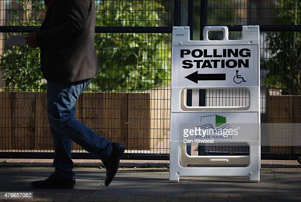 A member of the public arrives at a polling station on June 11 2015 in London England Voters in Tower Hamlets are going to the polls to vote for a...