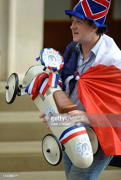 A member of the public arrives to deliver a gift outside St Mary's Hospital following the announcement of the birth of a baby boy to the Duke and...