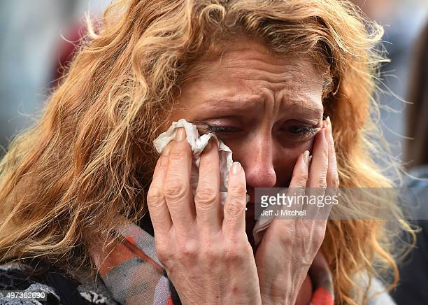 A member of the public cries during a minute's silence at La Belle Equipe cafe on Rue de Charonne one of the places attacked by terrorists on...