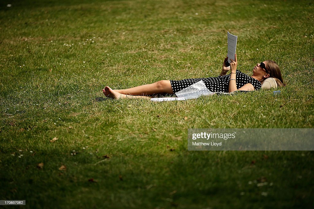 A member of the public enjoys the hot weather in St James Park on June 19, 2013 in London, England. Whilst the country is currently experiencing high temperatures, there has been a prediction by senior meteorologists that Britain may be expecting up to 10 years of rainy summers due to warming of the North Atlantic waters.