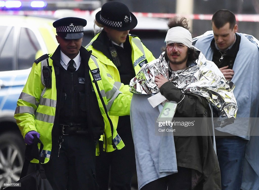 A member of the public is treated by emergency services near Westminster Bridge and the Houses of Parliament on March 22, 2017 in London, England. A police officer has been stabbed near to the British Parliament and the alleged assailant shot by armed police. Scotland Yard report they have been called to an incident on Westminster Bridge where several people have been injured by a car.