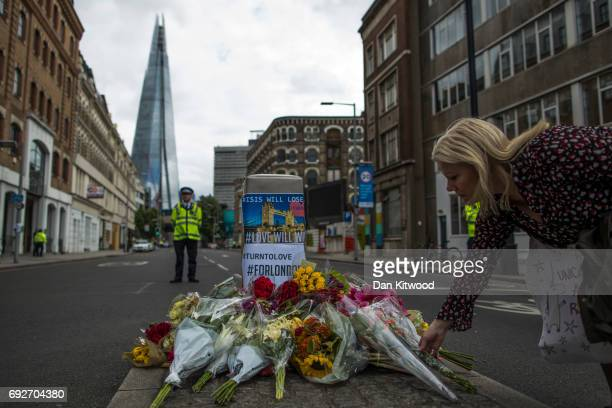 A member of the public lays flowers on the South side of London Bridge close to Borough Market in London in tribute to the victims of the June 3...