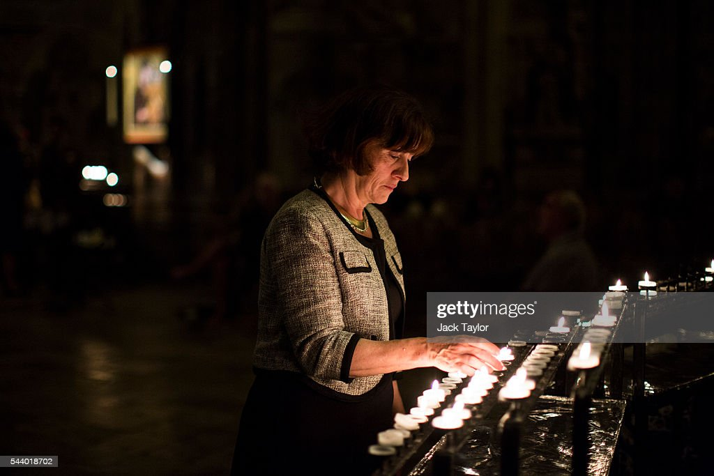 A member of the public lights a candle during a vigil to commemorate the centenary of the Battle of the Somme at Westminster Abbey on July 1, 2016 in London, England. The overnight vigil is being held to remember those who died in the Battle of the Somme which began 100 years ago on July 1st 1916. Armies of British and French soldiers fought against the German Empire and over one million lives were lost. The Grave of the Unknown Warrior contains the body of an unidentified British solider from the First World War buried in French soil and covered with a Belgian marble slab.