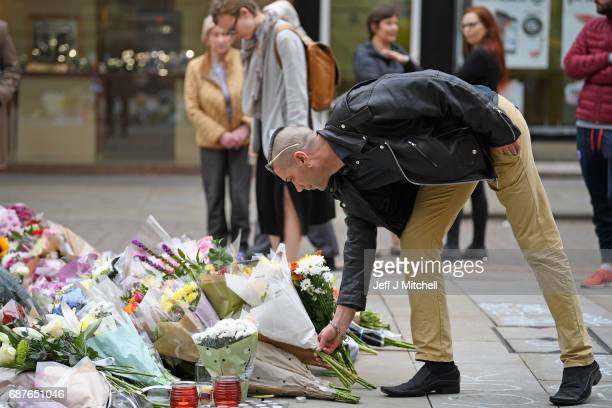 A member of the public places a floral tribute at St Anns Square on May 24 2017 in Manchester England An explosion occurred at Manchester Arena on...