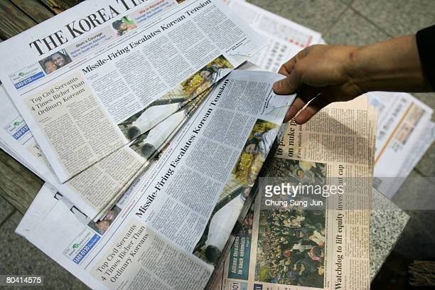 A member of the public reads a newspaper report regarding the North Korea testfired missile on March 28 2008 in Seoul South Korea North Korea...
