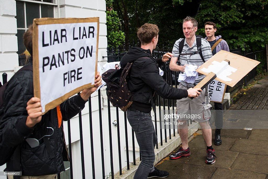A member of the public (2nd-R) scuffles with demonstrators as they wave underwear and placards with the words 'Liar Liar Pants On Fire' written on them outside the home of former London Mayor Boris Johnson on July 1, 2016 in London, England. Mr Johnson backed out of the Conservative Leadership contest yesterday after his ally and supporter Justice Secretary Michael Gove announced he too would run. Home Secretary Theresa May is now leading the race to head the Conservative Party that could lead to becoming Prime Minister.