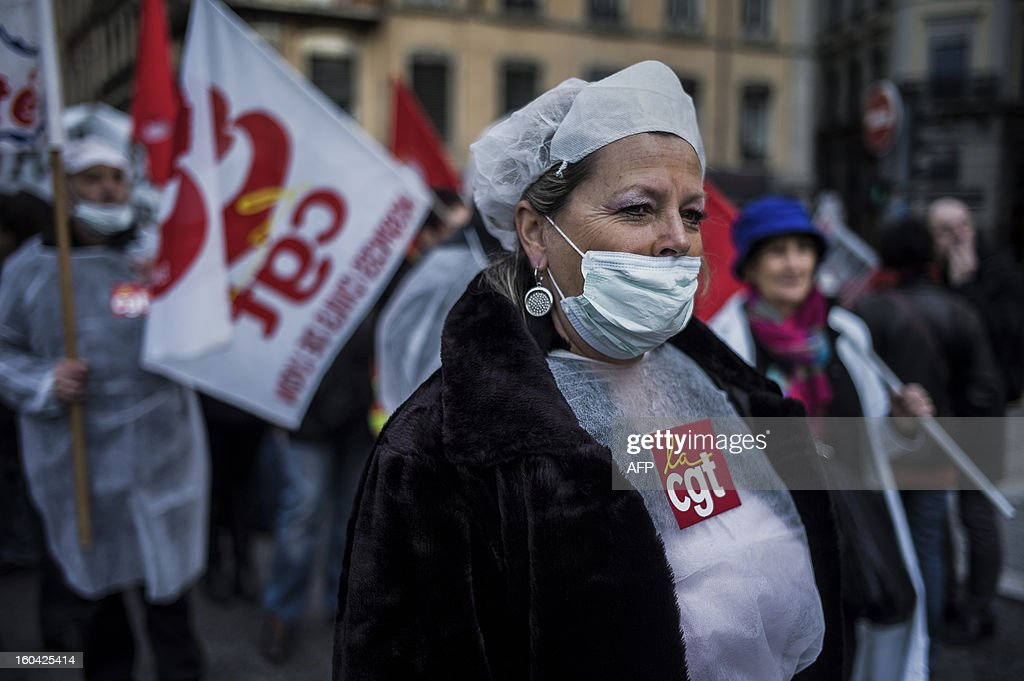 A member of the public sector, (education, health and finance) takes part on January 31, 2013 in a national day of protest in Lyon against the French government's social policy. For the first time since French President Francois Hollande's election, three labour unions (CGT, FSU, Solidaires) called on 5.2 million civil servants to stop working to show to the government their unhappiness, particularly in terms of purchasing power.