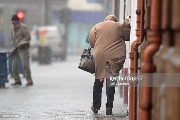 A member of the public struggles in poor weather conditions on December 10 2014 in Troon Scotland High winds and large waves are expected to hit the...