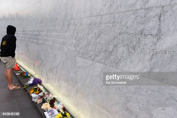 A member of the public takes a look at the names of the 185 people who died in the February 2011 earthquake which are placed on the Memorial Wall of...